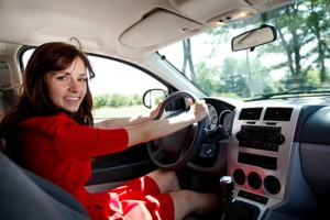 young girl driving car